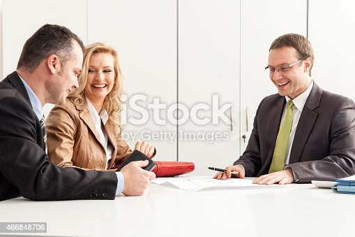 istock Agent Advises Happy Couple Over Blueprint 466848706