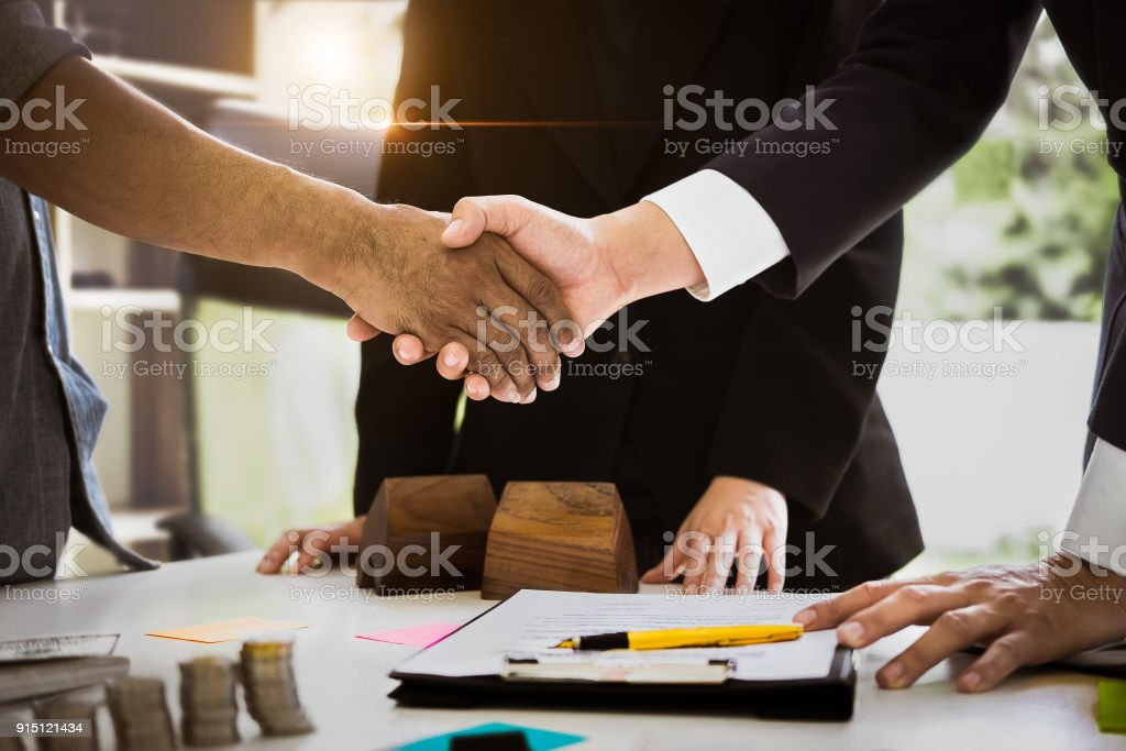 Agent and customer meeting and handshaking after good deal for buy house. Agreement and Real estate concept. stock photo