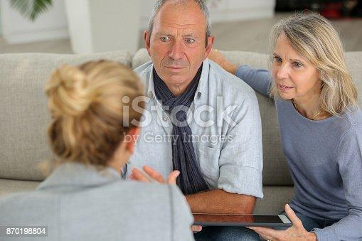 845085240 istock photo agent explaning contract to senior couple 870198804
