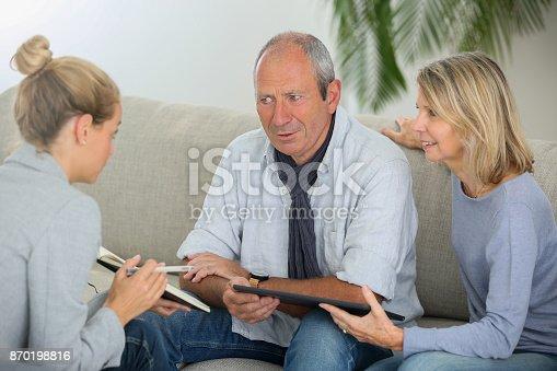 845085240istockphoto agent explaning contract to senior couple 870198816