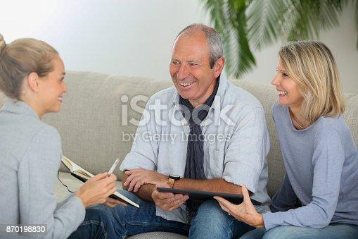 845085240istockphoto agent explaning contract to senior couple 870198830