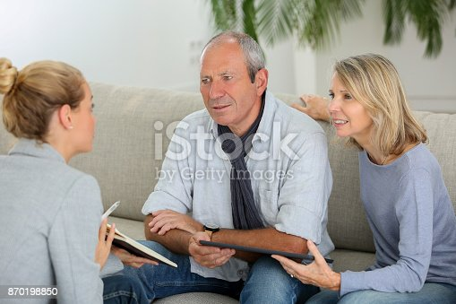 845085240istockphoto agent explaning contract to senior couple 870198850