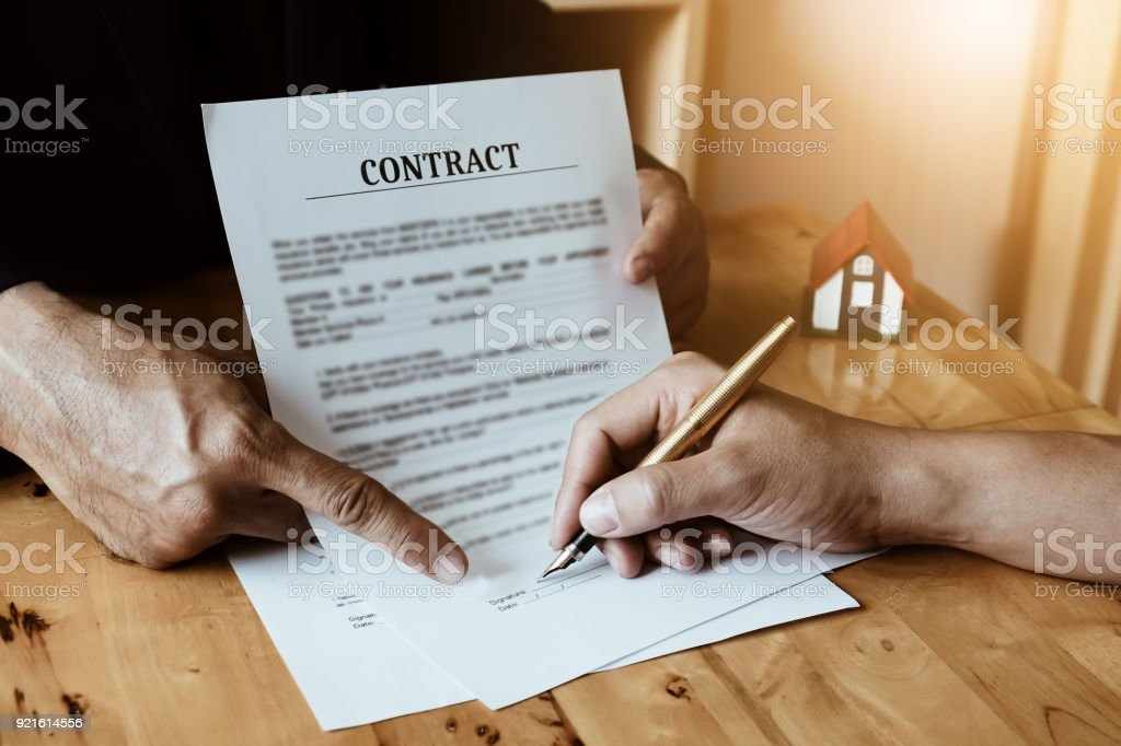 Agent give pen and documents insurance house with customer to sign contract. Agreement concept. stock photo