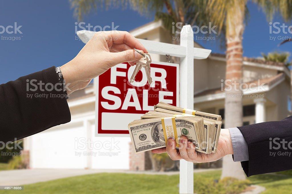 Agent Handing Over Keys, Buyer Handing Over Cash for House stock photo