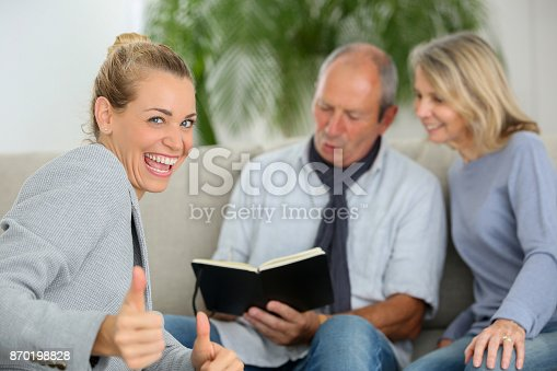 845085240istockphoto agent happy to sell new contract to senior couple 870198828