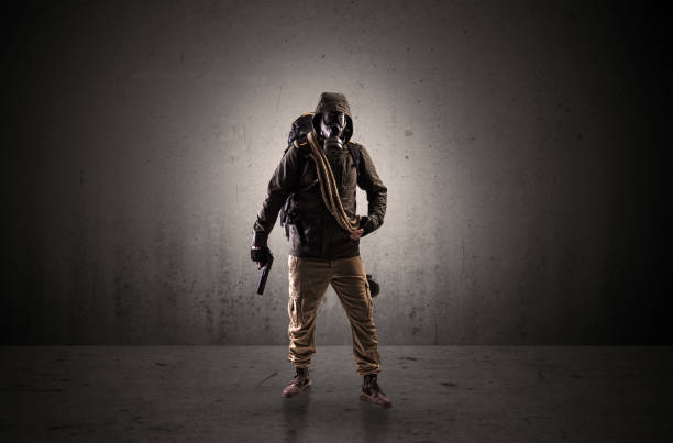 Agent in a dark space with arms Bad agent in a dark room with arms on his hand and gas mask bootes stock pictures, royalty-free photos & images