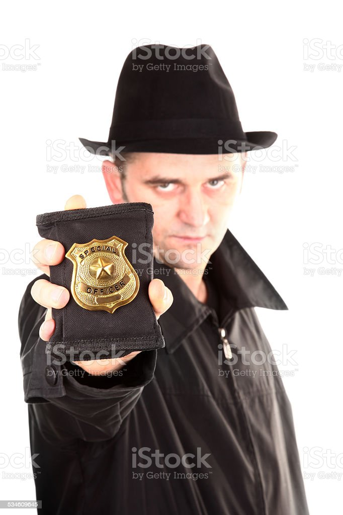 Agent is showing special officer badge stock photo