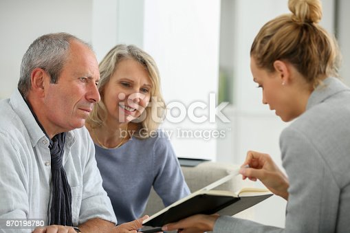 845085240istockphoto agent selling life insurance to retired couple 870198780