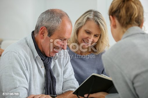 845085240 istock photo agent selling life insurance to retired couple 870198788