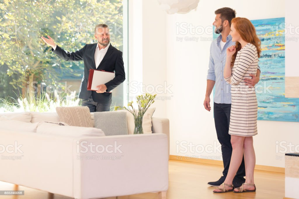 Agent showing home interior stock photo
