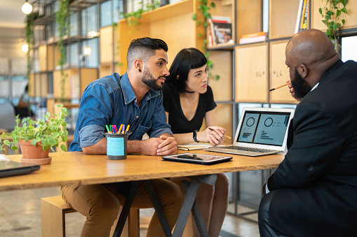 Agent Talking To A Couple In The Office Stock Photo - Download Image Now