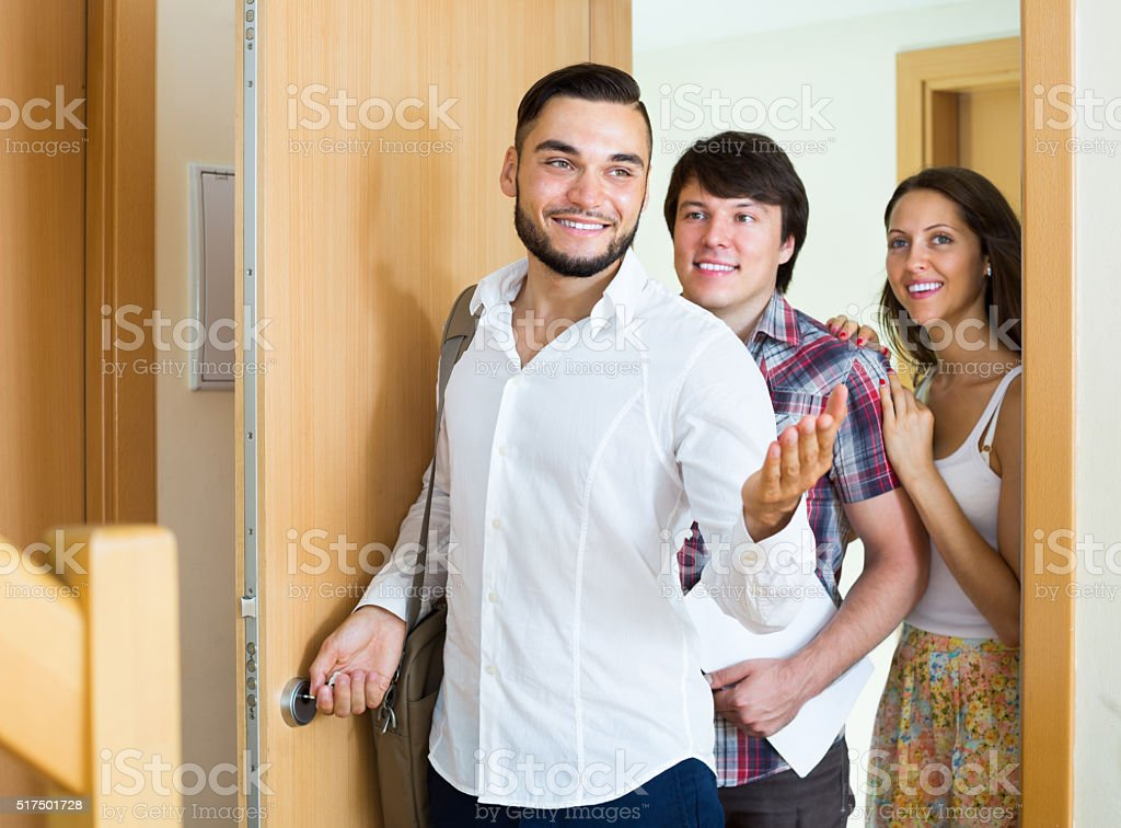 Agent tells about new flat to couple stock photo