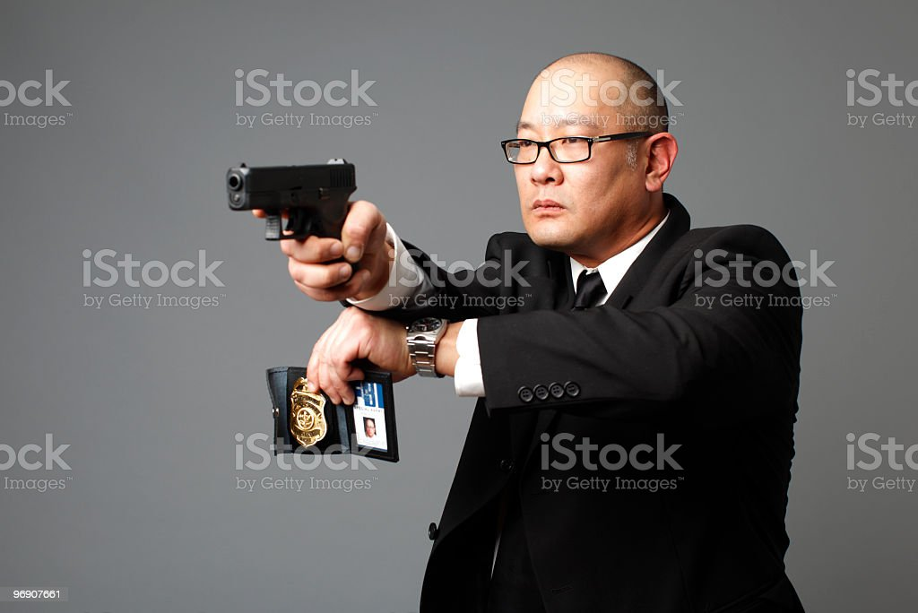 FBI agent with gun and badge royalty-free stock photo