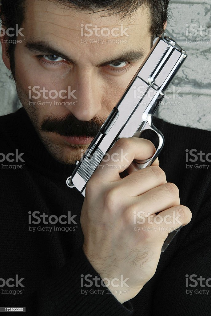 Agent with gun royalty-free stock photo