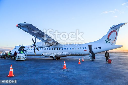 186763256 istock photo agents charges luggages while passengers ride of the airliner 618340148