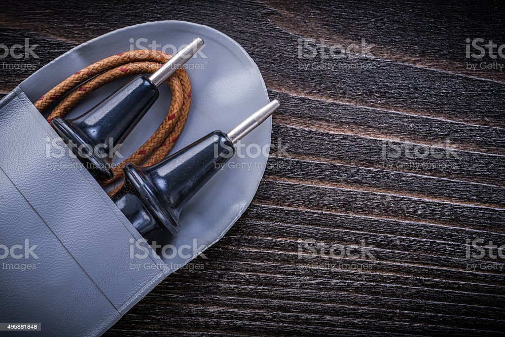 Age-old electrical tester on wooden background electricity conce stock photo