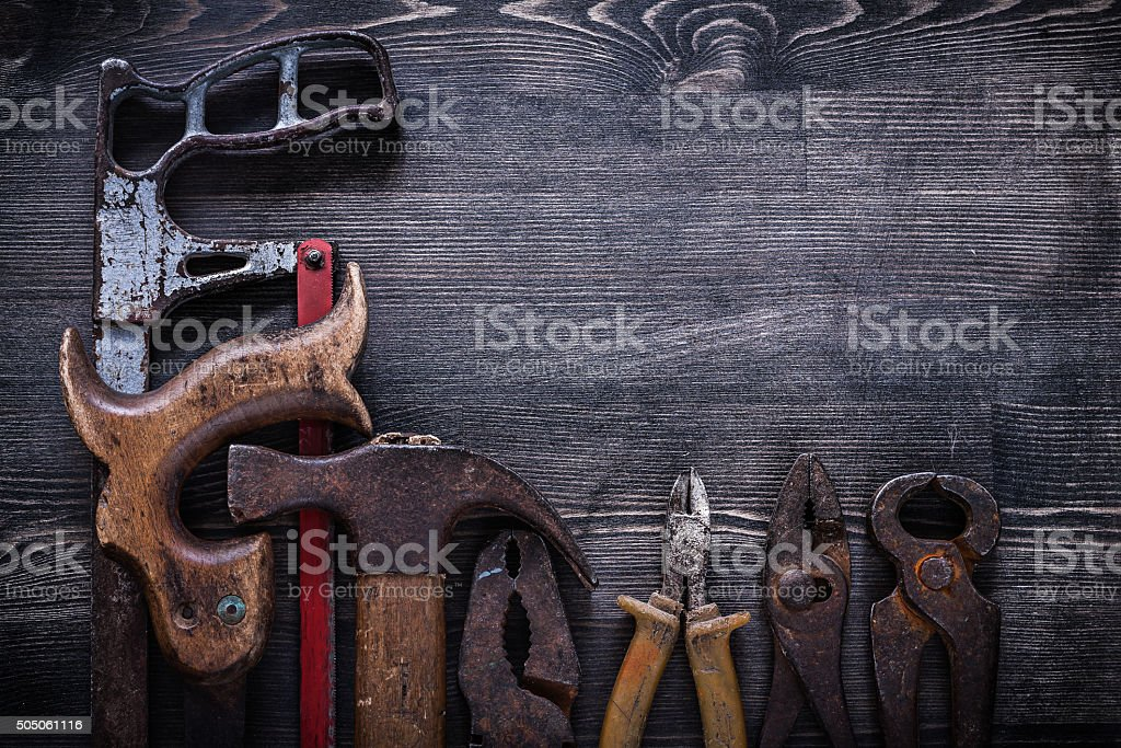 Age-old hacksaw nippers pliers steel cutter claw hammer construc stock photo
