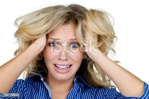 Woman with very upset look having a bad hair day and isolated on white background