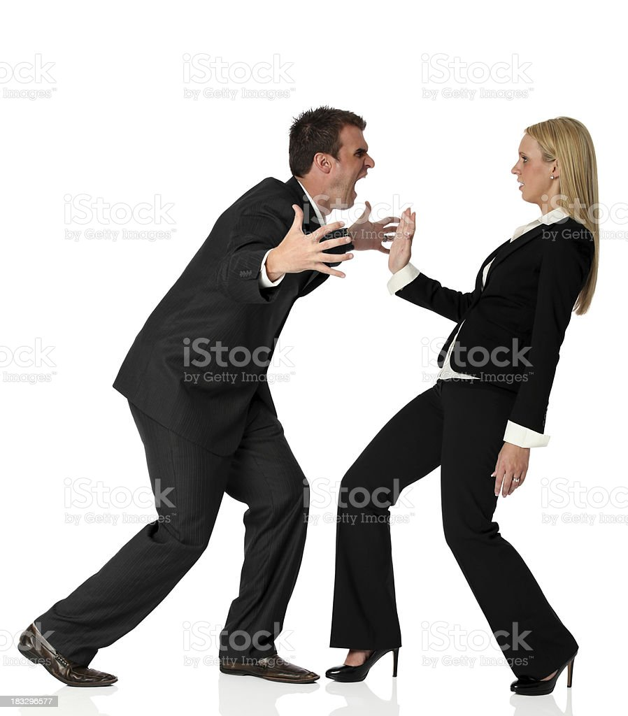 Aggressive businessman attacking on businesswoman royalty-free stock photo