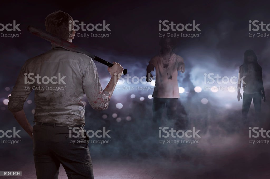 Aggressive businessman seeing zombies with a baseball bat stock photo
