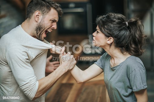 istock Aggressive couple arguing about their problems at home. 944258940