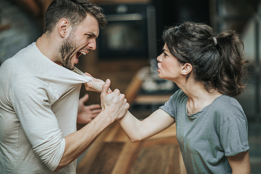 Furious couple fighting while having problems in their relationship.