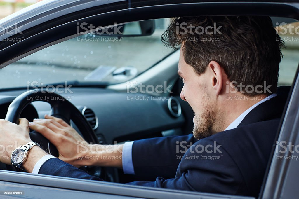 Aggressive driver in car, side view stock photo