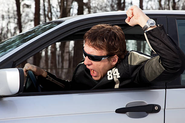 Aggressive driver swearing  shock tactics stock pictures, royalty-free photos & images