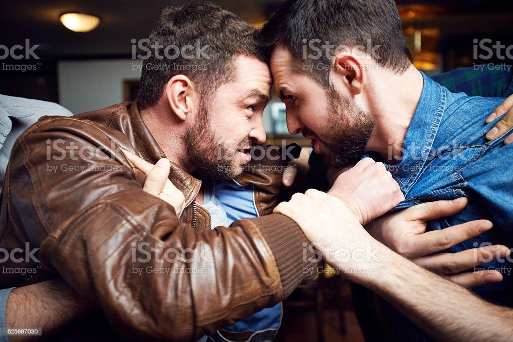 Aggressive drunken men in pub stock photo