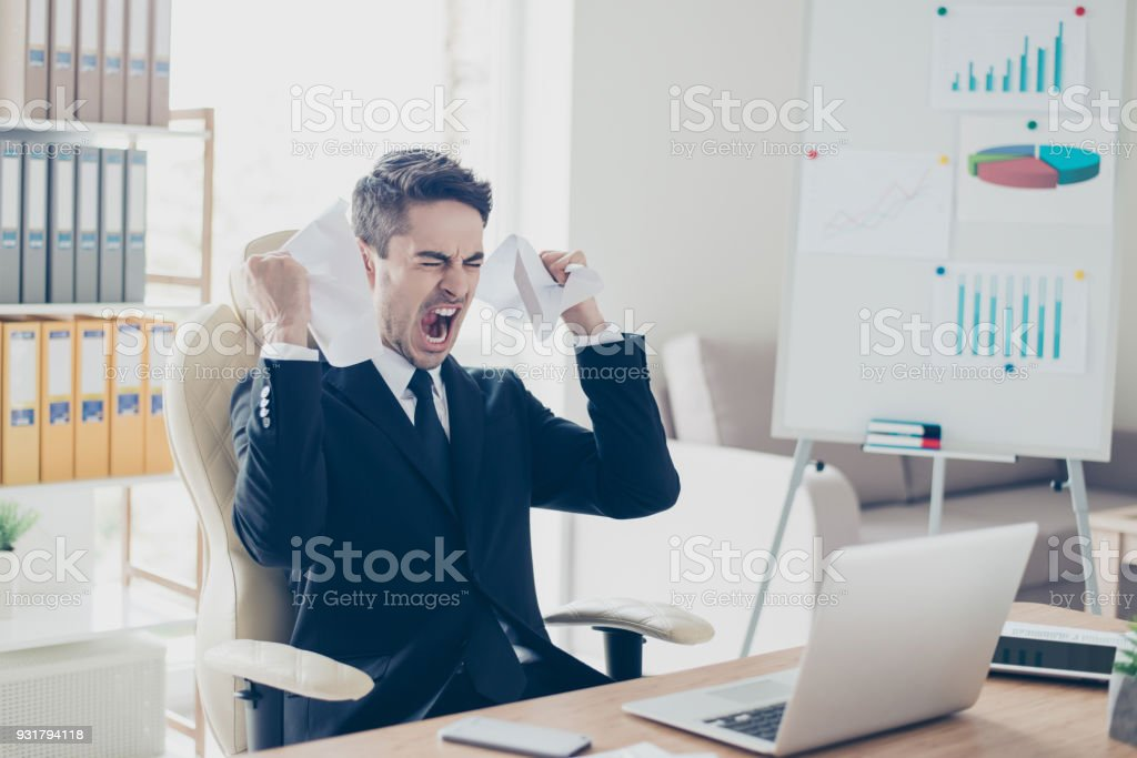 Aggressive irritated despair nervous fury people overworking tiredness workpaper person concept. Portrait of sad upset yelling screaming unsatisfied agent holding contract sitting on armchair stock photo