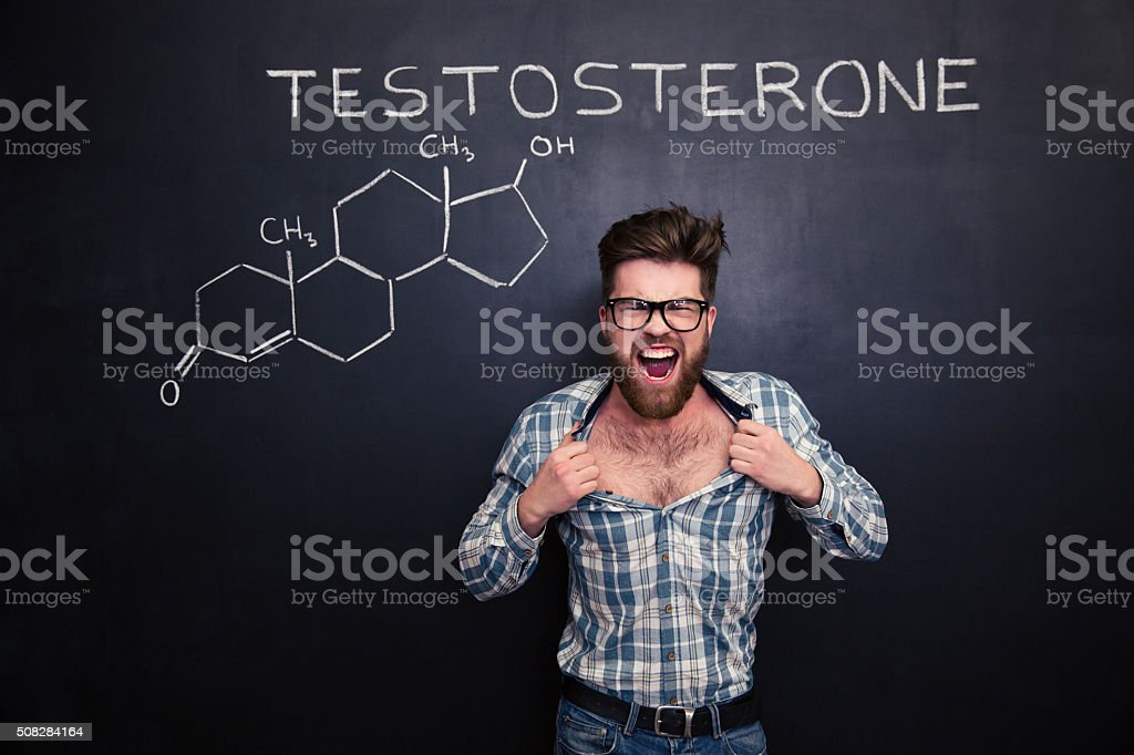 Aggressive man in glasses screaming and tearing off his shirt stock photo