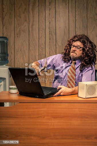 618210072 istock photo Aggressive Retro Office Worker Smashing his Computer with Hammer 155439229