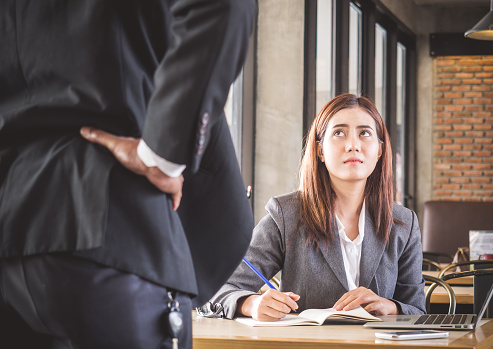 istock Aggressive/angry boss complaining asian business woman(casual uniform) in cafe office 871200498