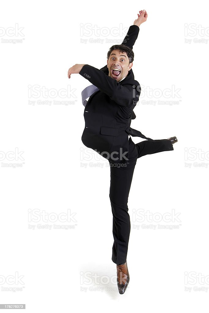 Agile businessman doing a pirouette royalty-free stock photo