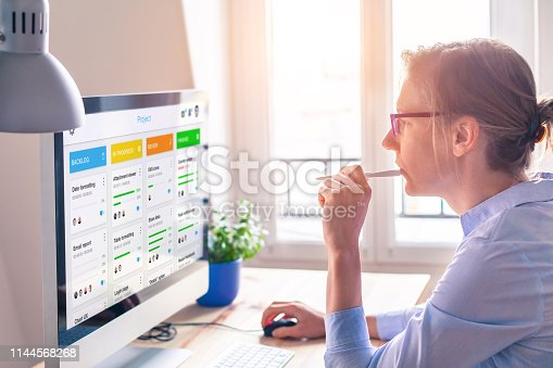 istock Agile framework board for lean product development with scrum or kanban methodology, project management with iterative or incremental strategy, young woman working with computer 1144568268