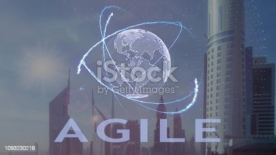 952856170 istock photo Agile text with 3d hologram of the planet Earth against the backdrop of the modern metropolis 1093230216