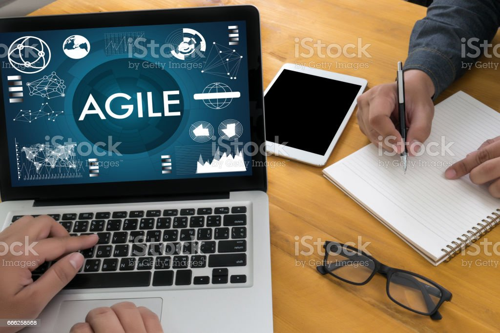 AGILE Agility Nimble Quick Fast Concept businessman working stock photo