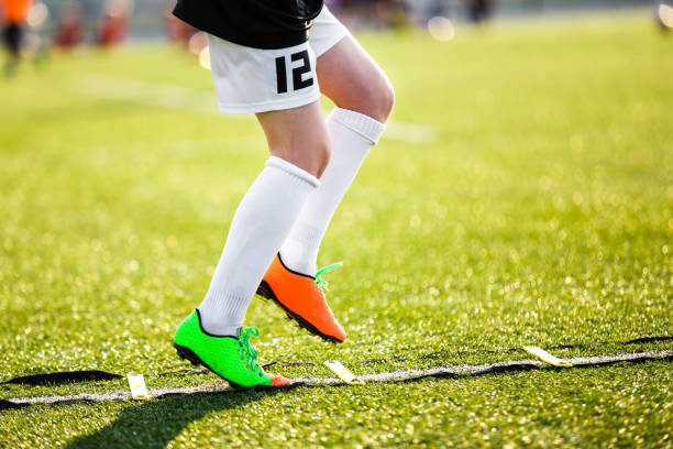 Agility Training For Soccer Players. Professional Soccer Player Individual Skill Training. Soccer Speed Ladder Drills. stock photo