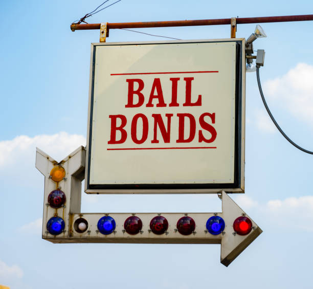 Aging Vintage Sign in Front of Small Town Bail Bonds Office stock photo