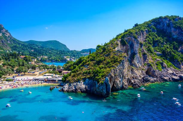 Agios Spiridon Beach with crystal clear azure water and white beach in beautiful landscape scenery - paradise coastline of Corfu island at Paleokastritsa, Ionian archipelago, Greece.