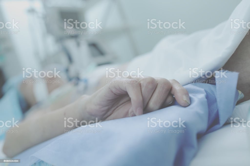 Agony of irremediable patient in ICU stock photo