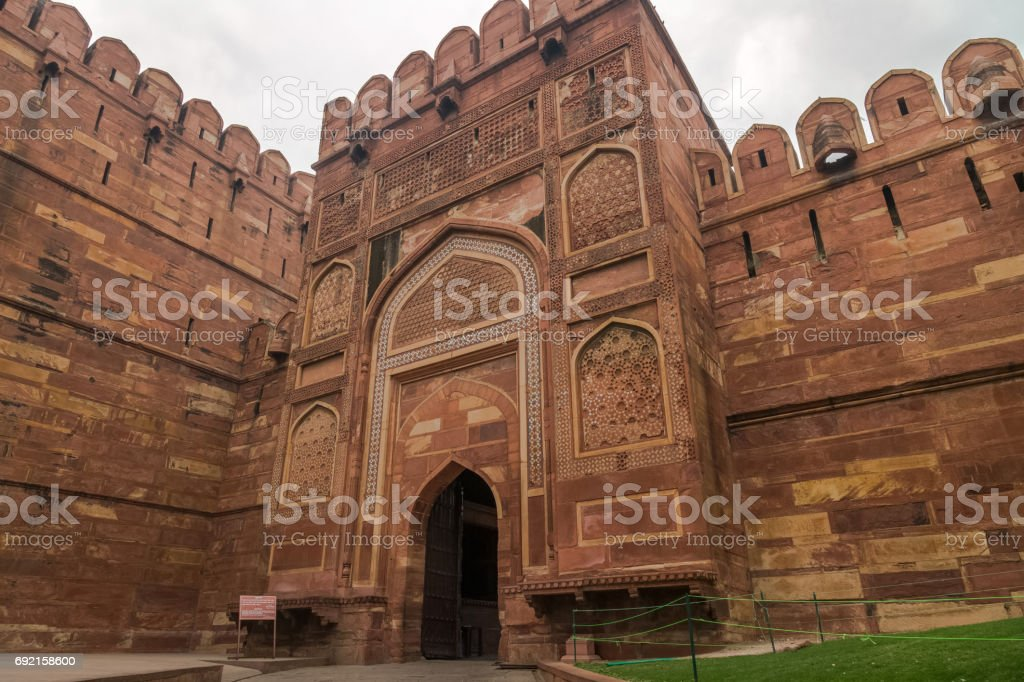Agra Fort also known as the Red Fort Agra is an intricately carved historic red sandstone fort in the state of Uttar Pradesh India. stock photo