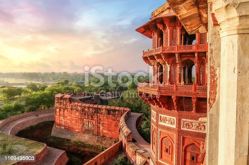 Agra Fort - Famous medieval historic fort exterior structure with view of Agra city landscape at sunrise