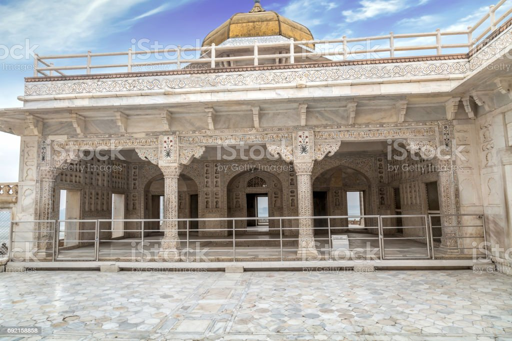Agra Fort interior with white marble architectural carvings and portico structure. View of intricately carved royal palaces of Agra Fort. stock photo