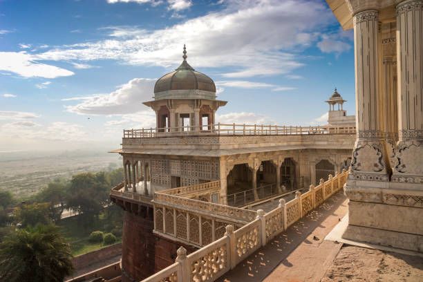Agra Fort white marble architectural carvings and portico structure. View of intricately carved Diwan-i-Khas and Musamman Burj dome of Agra Fort. stock photo