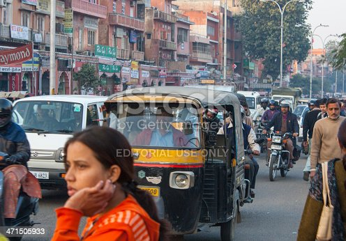 Agra, India - January 08, 2011: A crowded street  as city dwellers go about their business in Agra just outside the gates of the Taj Mahal.