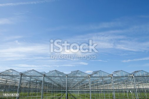 istock agrarian greenhouse against a blue sky 182418732