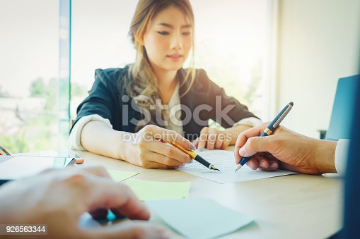 istock Agreement paper,estate agent gives pen and documents agreement with customer to sign contract. 926563344