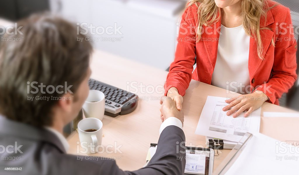 Agreement Male and female business people shaking hands 2015 Stock Photo