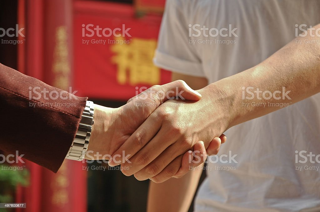 Agreement reached between the rich and the poor in China royalty-free stock photo